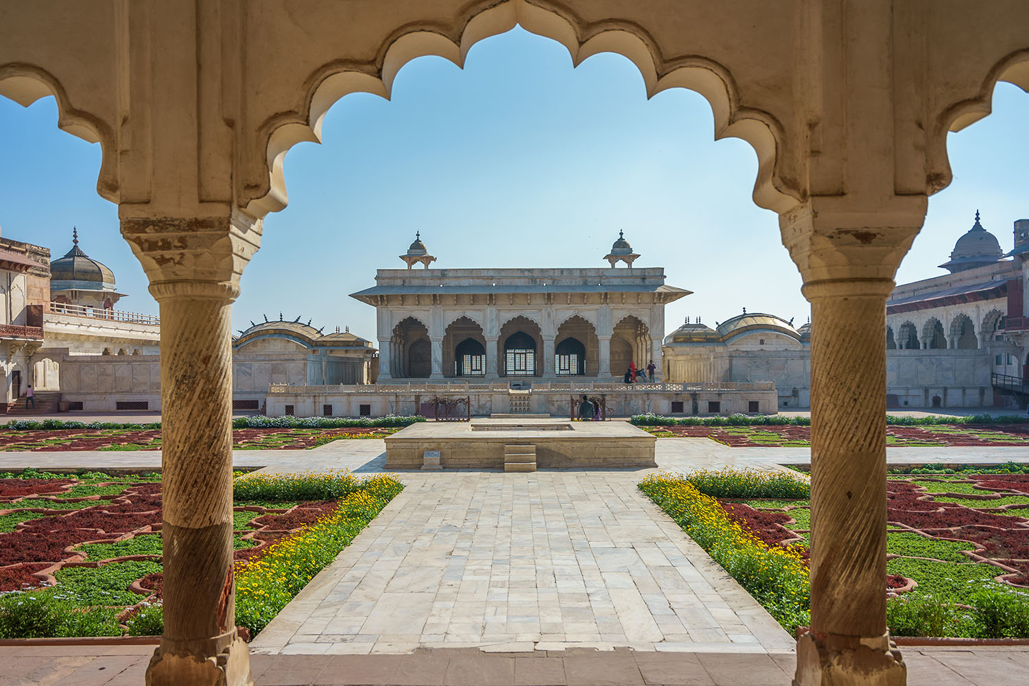 Looking into a courtyard at Agra Fort through a marble archway